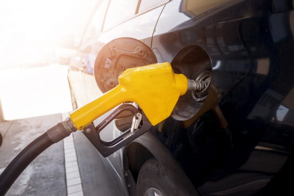 Close up of car is refilling oil fuel in Gas Station